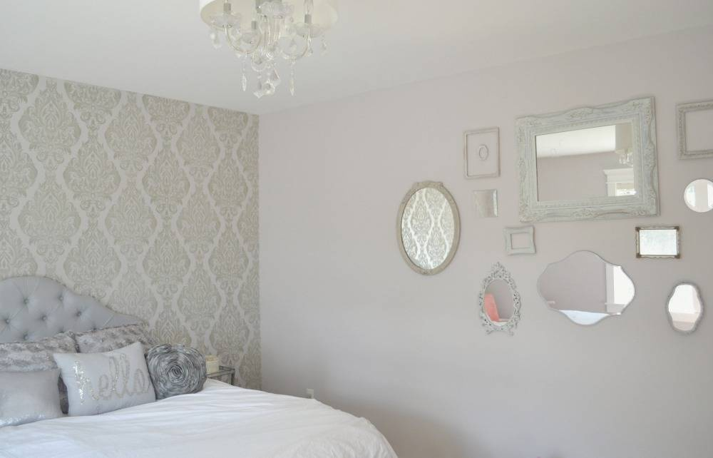 Mirrors hanging on grey bedroom wall