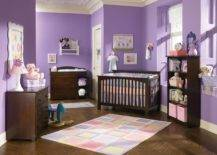 Nursery with purple wall and brown furnitures