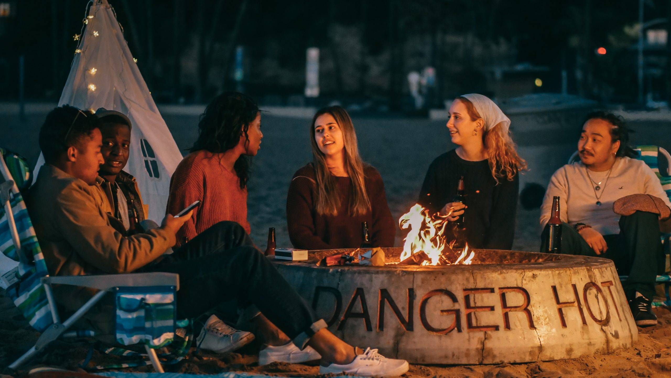 People sitting around fire pit