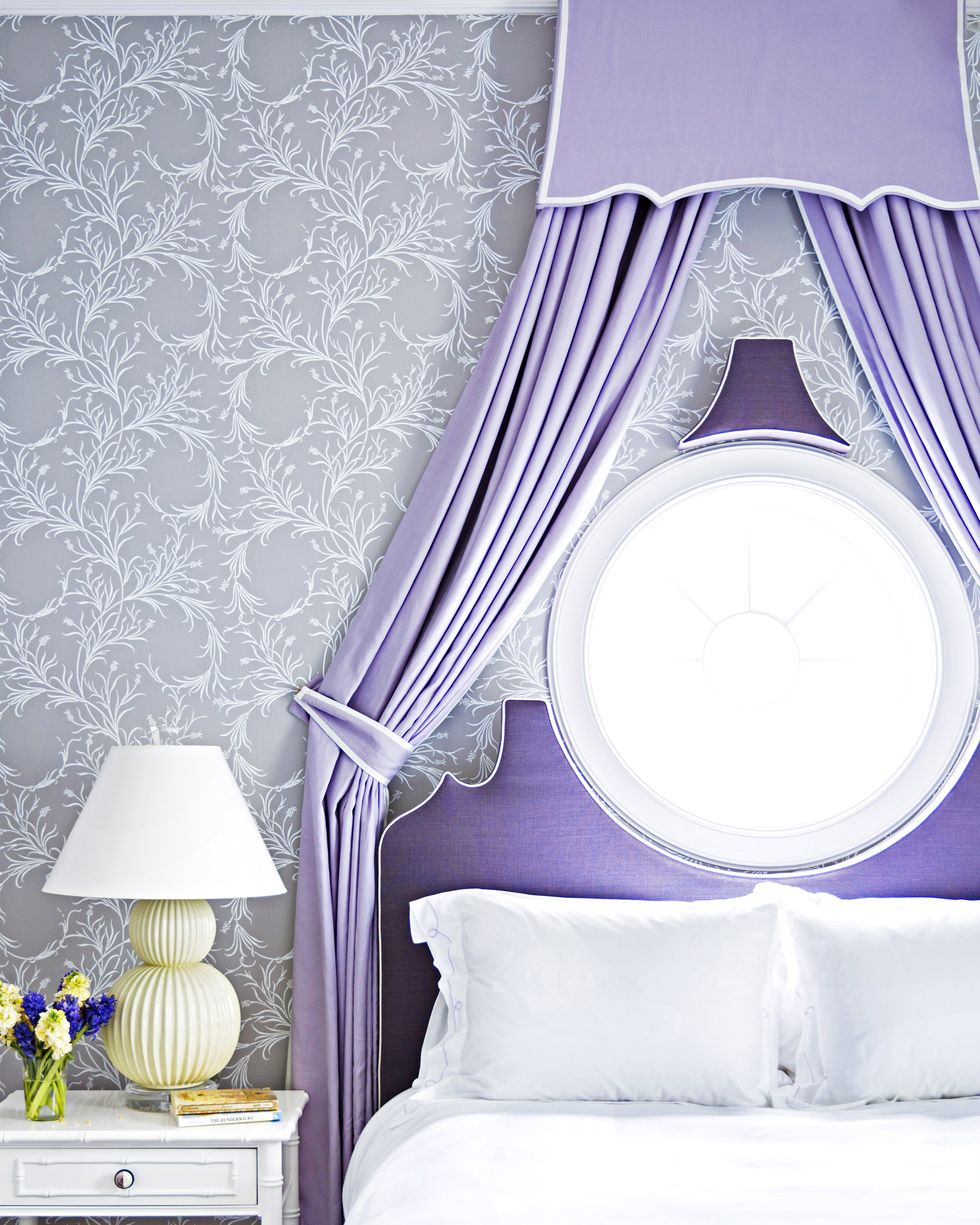 Purple bed with purple drapery