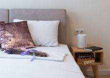 Purple cushion and lavender on bed