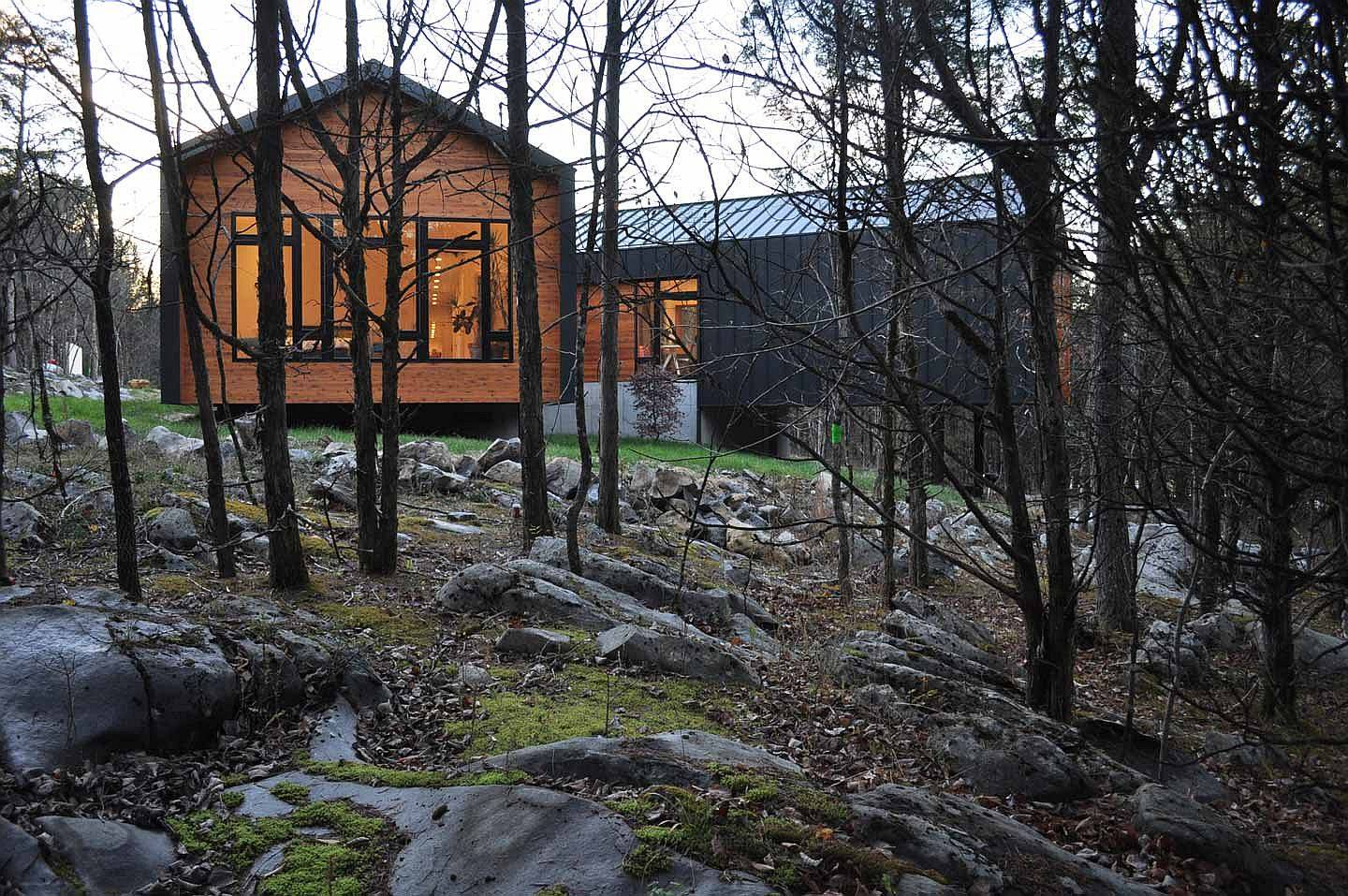 Rocky landscape around Holston River House shapes its overall form