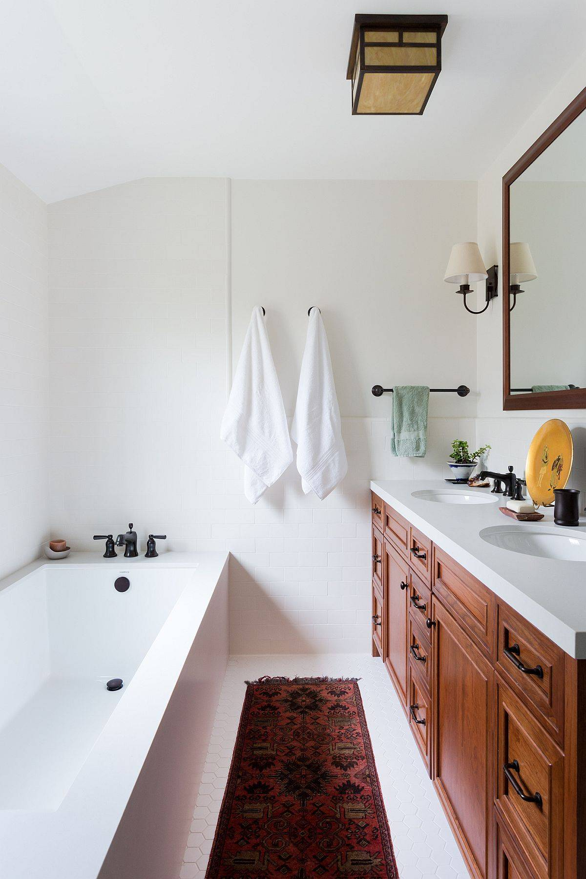 Rug-in-the-white-bathroom-complements-the-hue-of-the-wooden-vanity-in-here-95279