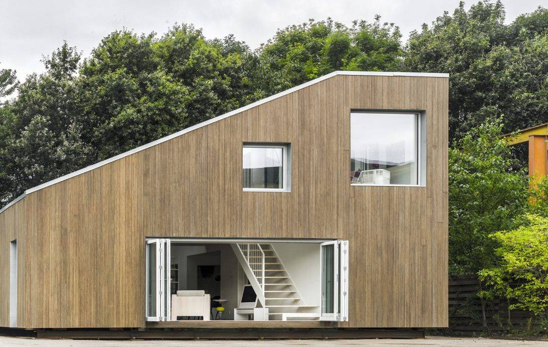 Sloped roof container house with two large windows