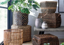 Stack of woven baskets with green plant