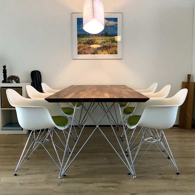 Table with six white chairs