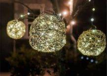 Three balled outdoor lights hanging from tree