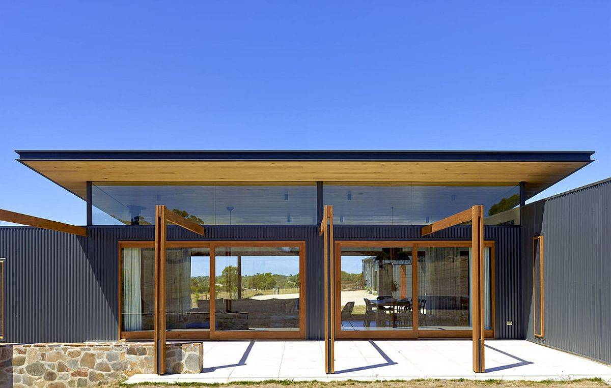 Timber glass and corrugated steel shape the exterior of this modern-rustic Aussie home