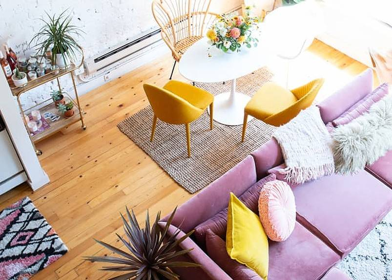 Top view of lavender sofa with cushions and coffee table with yellow chairs.v1