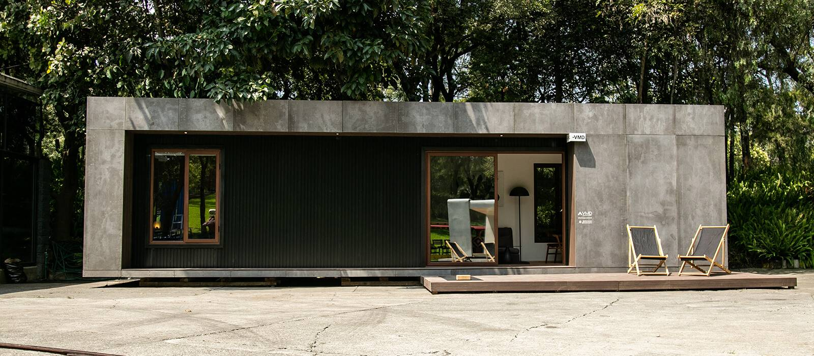 Two lounge chairs outside container home