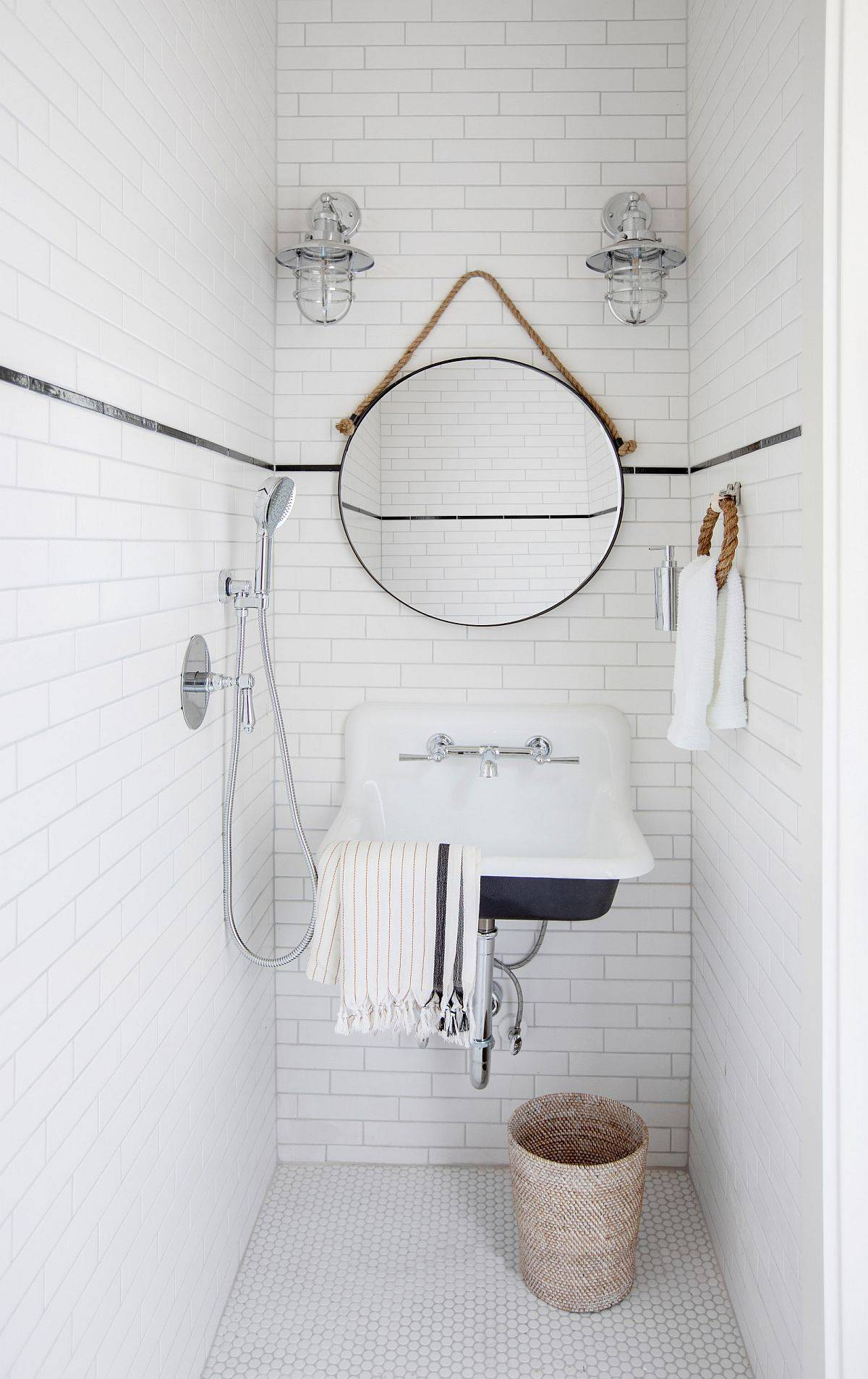 Use black in the all-white bathroom to define features and add visual interest