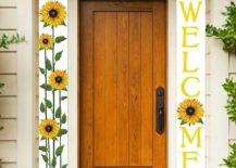 Welcome and sunflower banners on either side of brown door