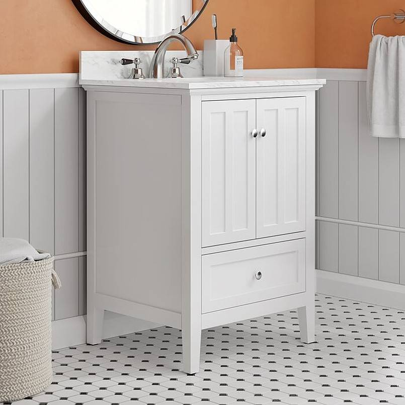 White bathroom vanity set beside hamper