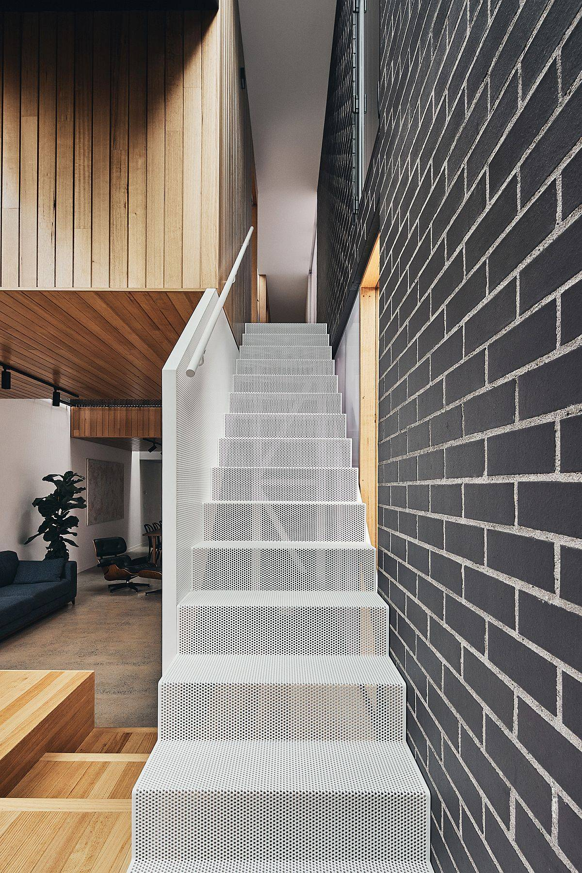 Wiry mesh-styled staircase leads to the top level of the home with bedrooms