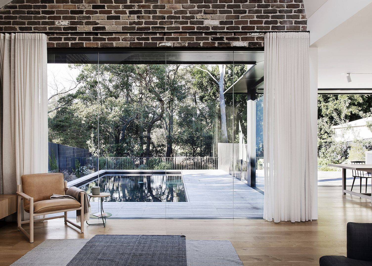 Wonderful-view-of-the-pool-area-and-the-green-outdoors-thanks-to-the-floor-to-ceiling-glass-walls-16715