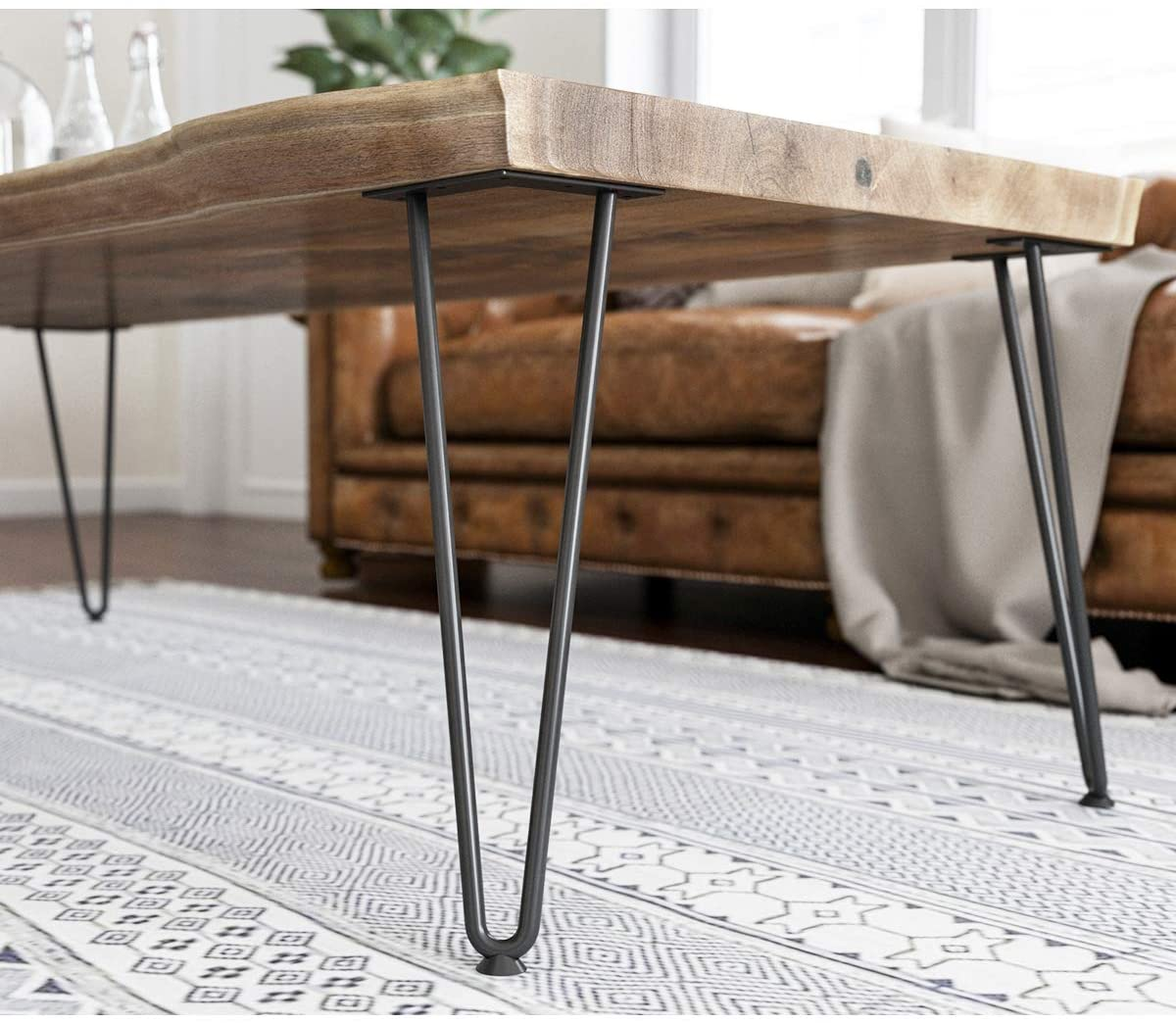 Wood table with thin metal legs