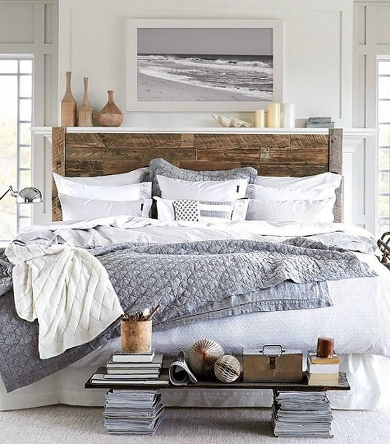 Wooden bed with grey and white sheets
