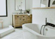 Wooden-vaniy-and-floating-wooden-shelf-is-perfect-for-this-relaxing-modern-white-bathroom-52935-217x155