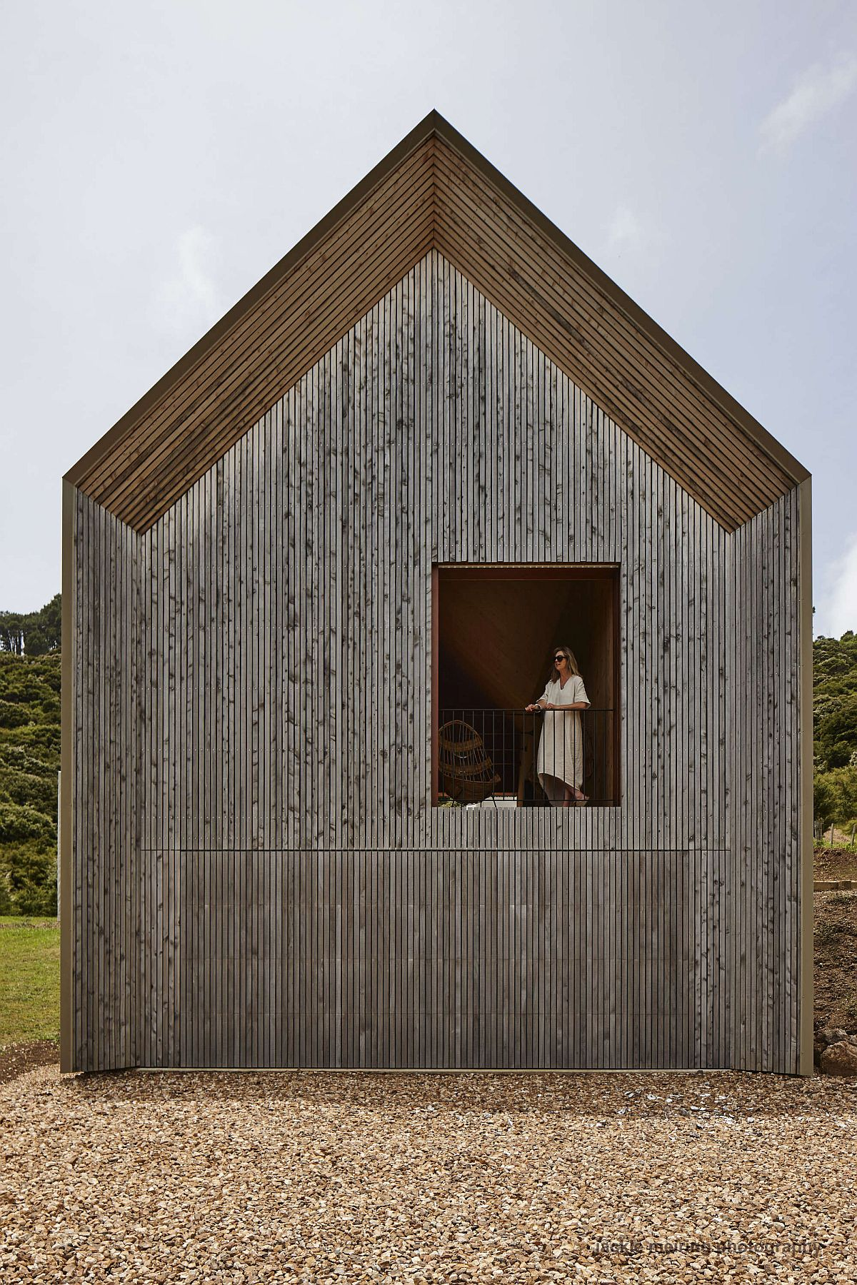 Woodsy-exterior-of-the-house-with-a-chapel-like-design-and-large-windows-63905