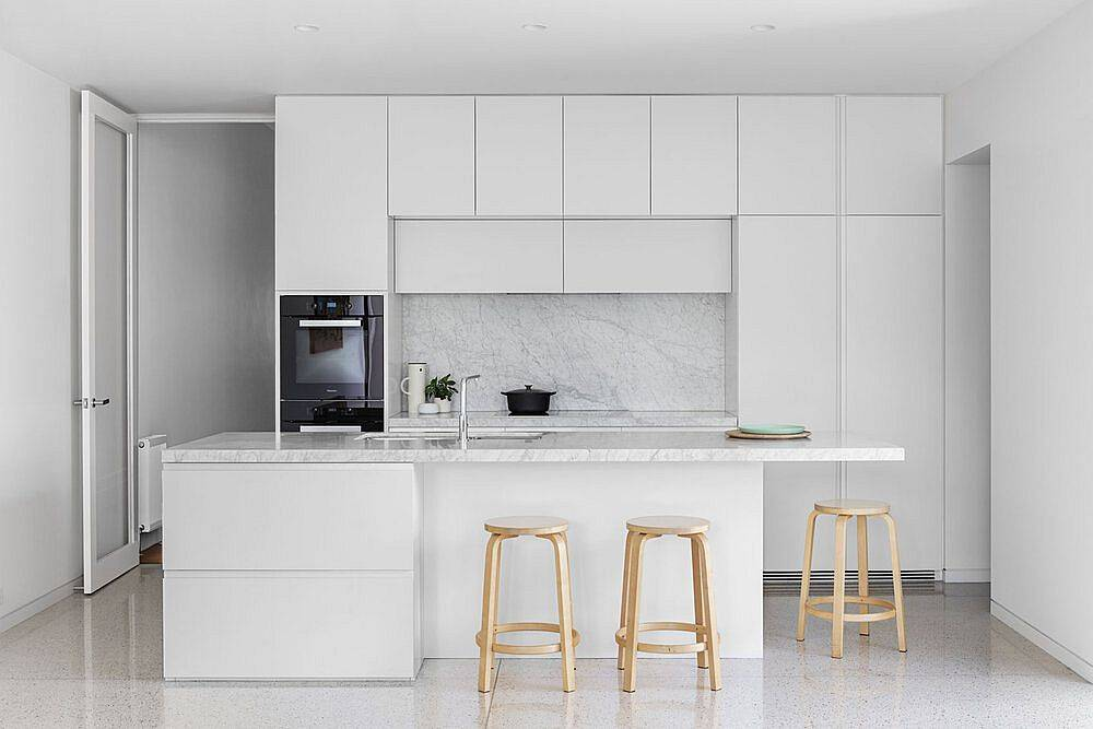All-white-modern-kitchen-design-idea-with-stone-countertops-and-polished-shelves-47209