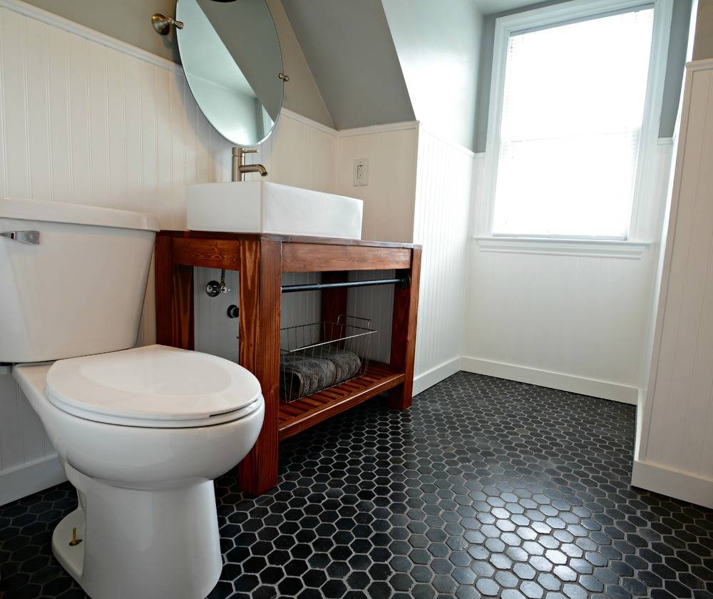 Bathroom with black hexagon tile flooring