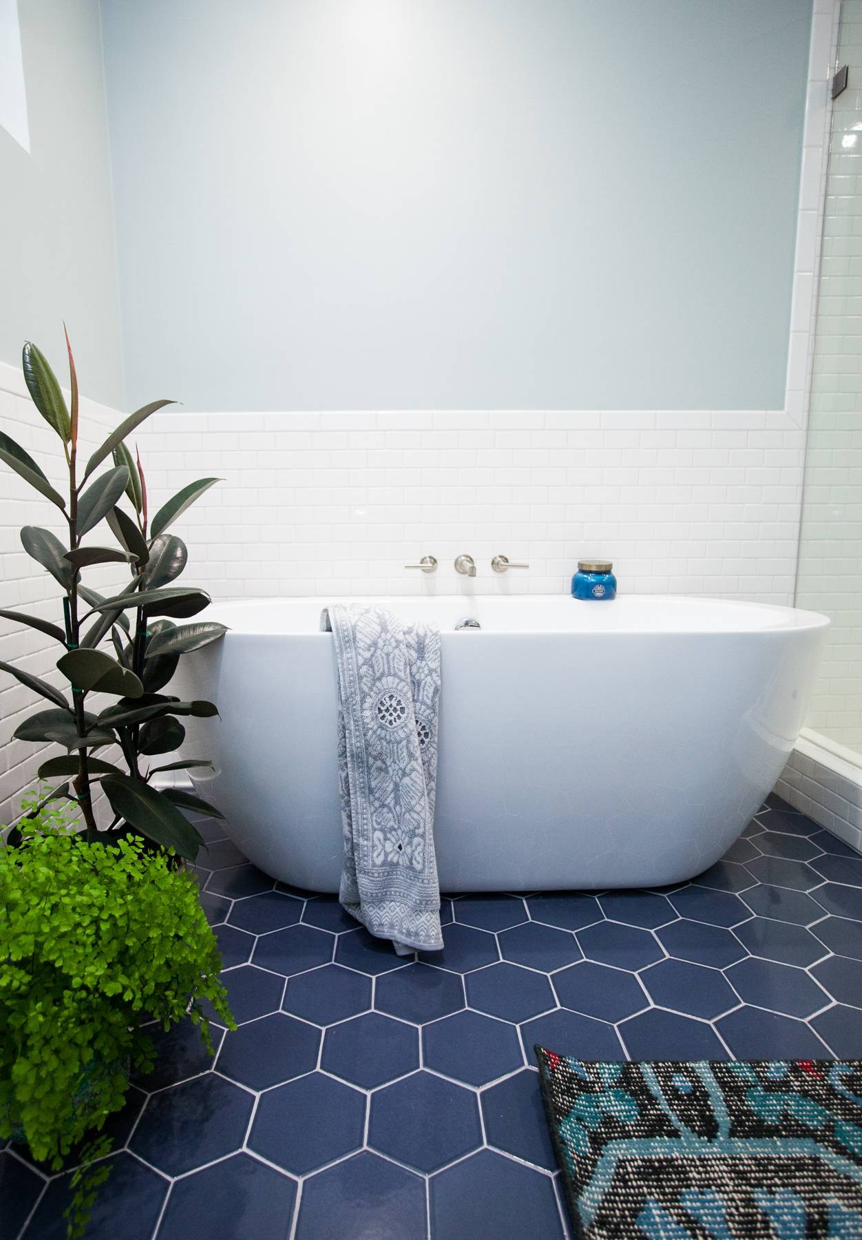 Bathtub on blue hex tiles