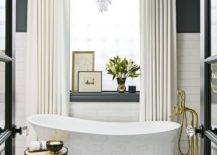 Bathtub with gold legs and faucet