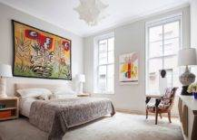 Beautiful-and-relaxing-bedroom-of-the-Tribeca-home-with-white-backdrop-and-eye-catching-colorful-wall-art-80554-217x155