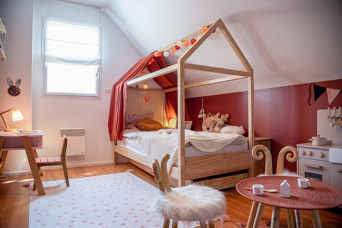 Beautiful terracotta girls' bedroom with custom decor and ample natural light