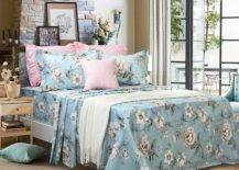 Bed with blue and pink floral sheets