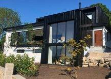Black and white box house with glass panels