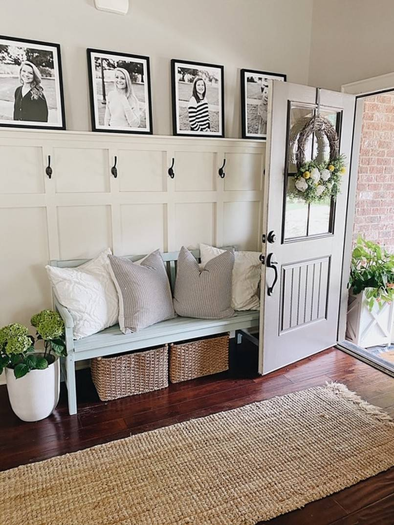 Black and white photos hanging on the wall in the entryway