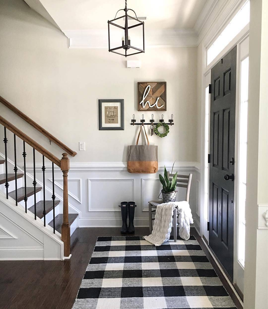 Black and white rug under the stairs