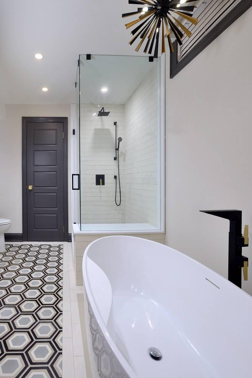 Black bathroom door beside shower