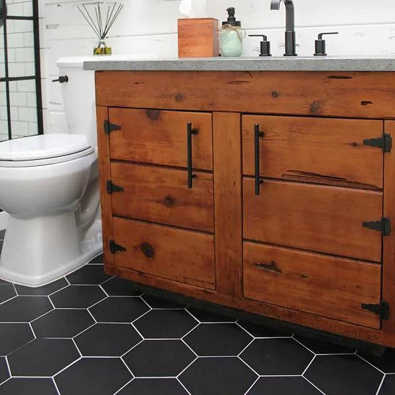 Black hexagon tiles on bathroom floor