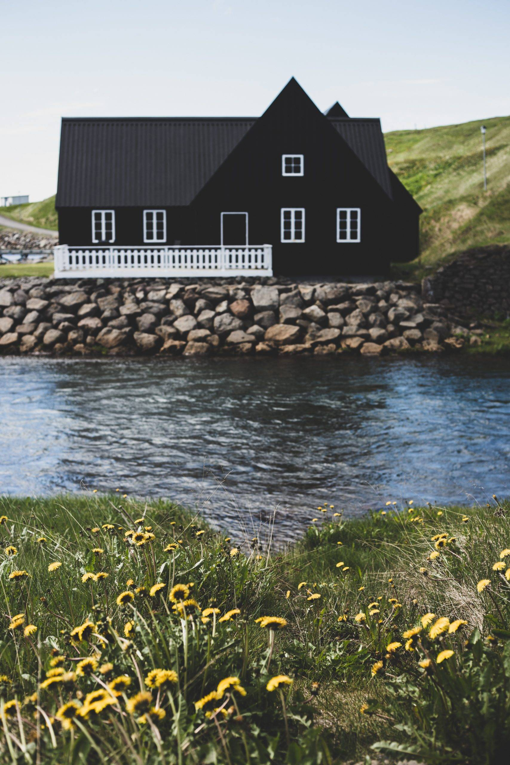 Black house by the river