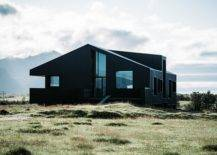 Black house in the middle of bare land