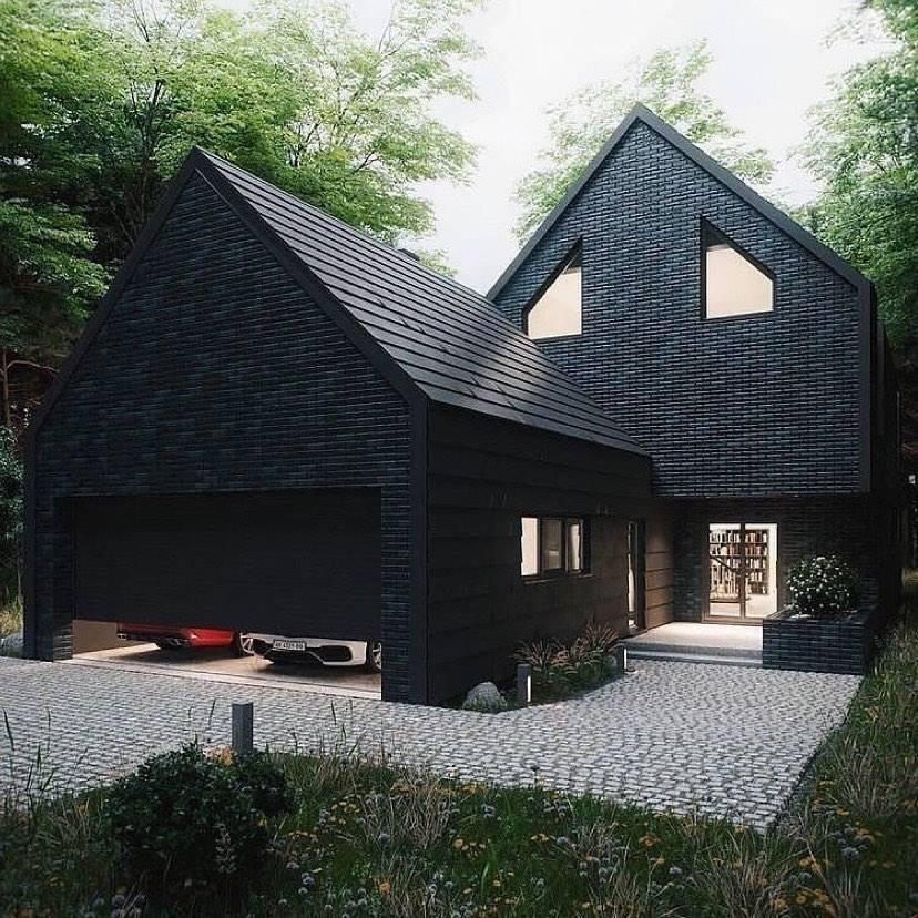 Black house with semi-open garage door