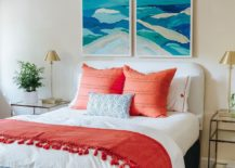 Bold-and-bright-coral-accent-pillows-along-with-blue-wall-art-steals-the-show-in-this-bedroom-11846-217x155