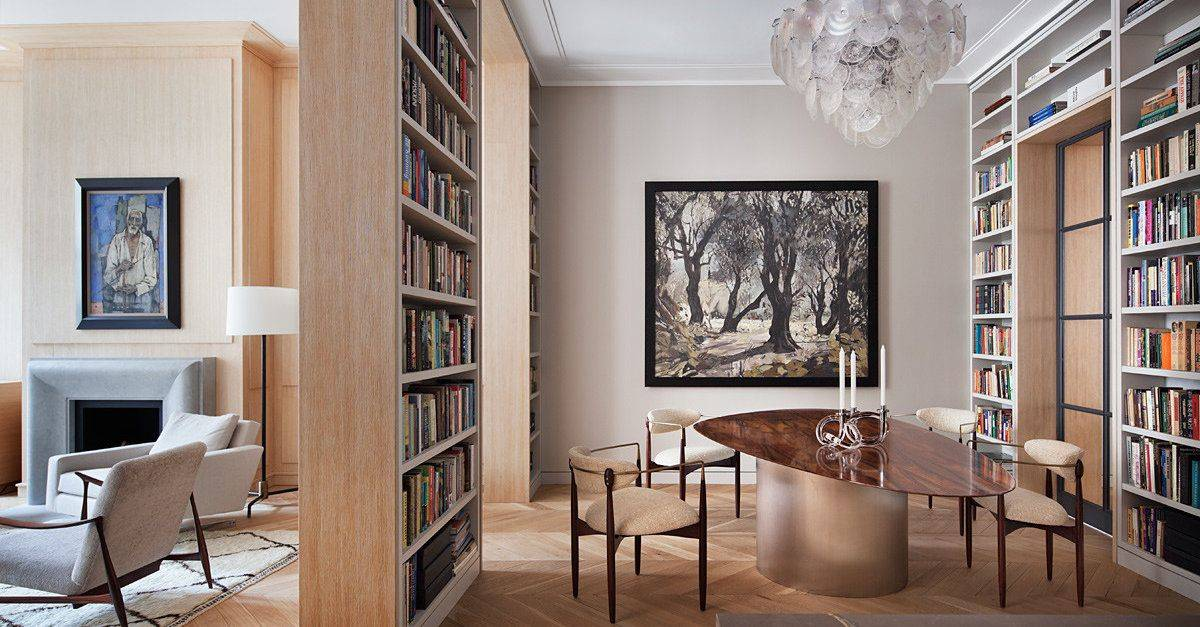 Bookshelves-from-floor-to-ceiling-surround-this-contemporary-dining-area-while-also-creating-doorways-34865