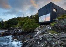 Box black house on rocks