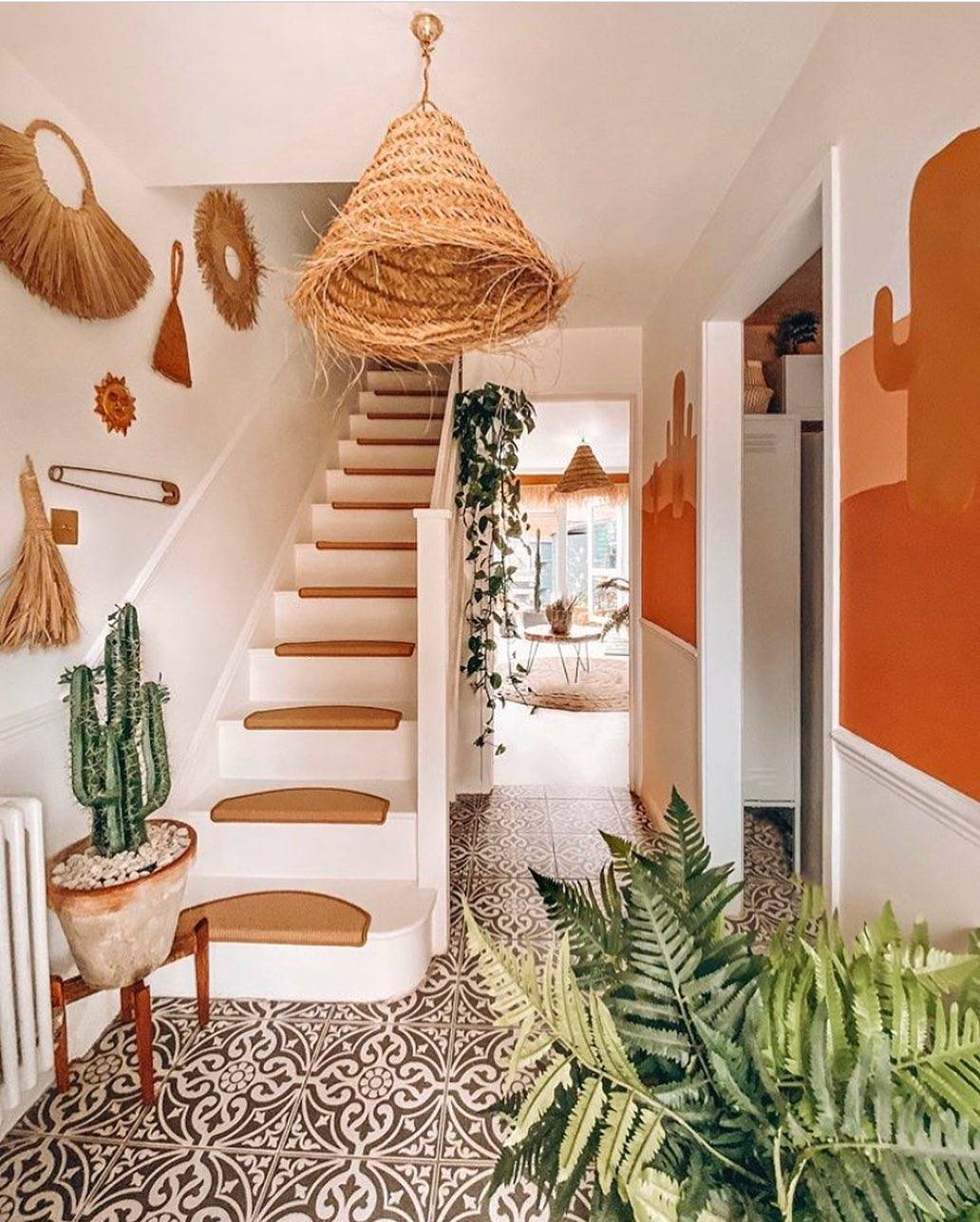 Carpeted entryway with woven decorations and plants
