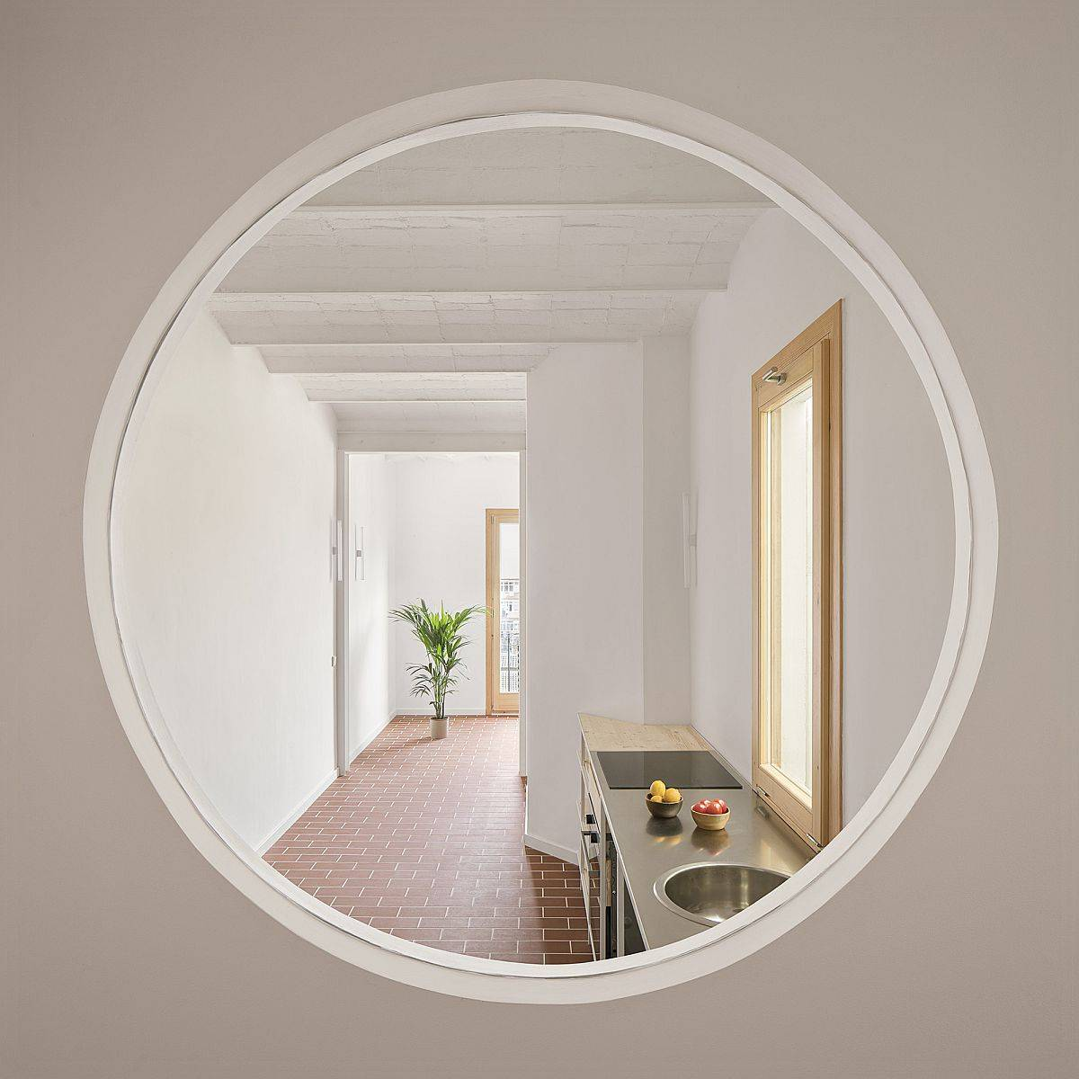 Circular-window-connects-the-kitchn-and-the-living-area-with-the-dining-space-or-secondary-room-42282