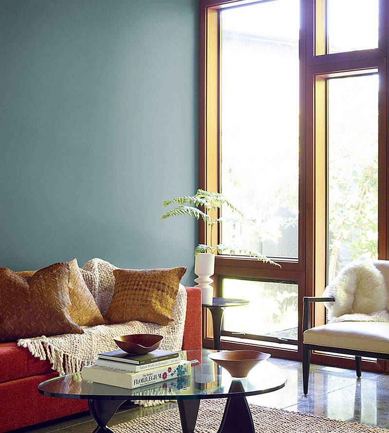 Combine a teal backdrop with other fabulous bright colors in the living room