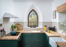 Creative-window-design-coupled-with-dark-green-cabinets-and-wooden-countertops-for-the-small-eclectic-kitchen-31162-217x155