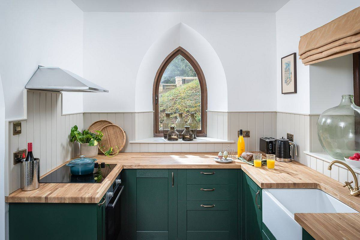 Creative-window-design-coupled-with-dark-green-cabinets-and-wooden-countertops-for-the-small-eclectic-kitchen-31162