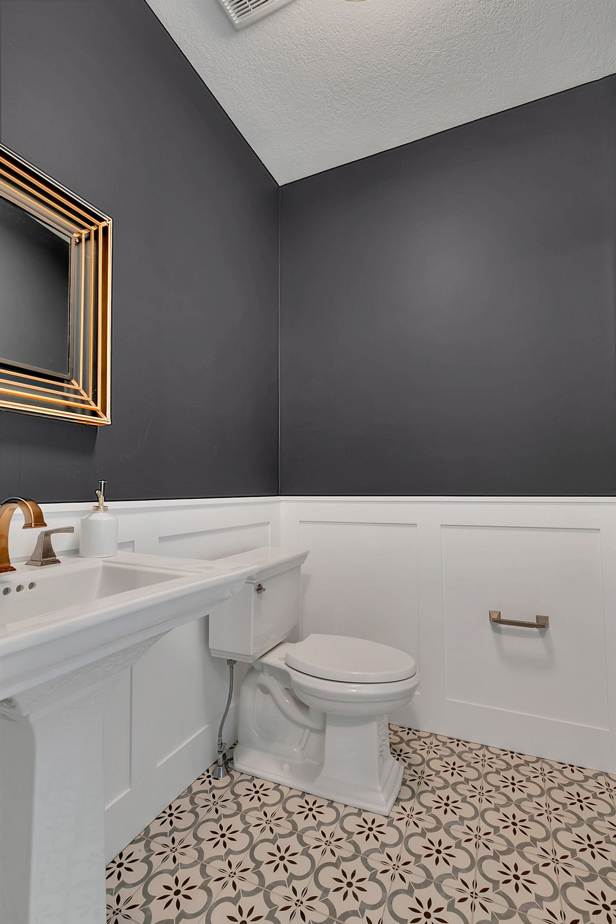 Dark-gray-and-white-bathroom-with-patterned-tiles-that-usher-in-more-visual-contrast-62386
