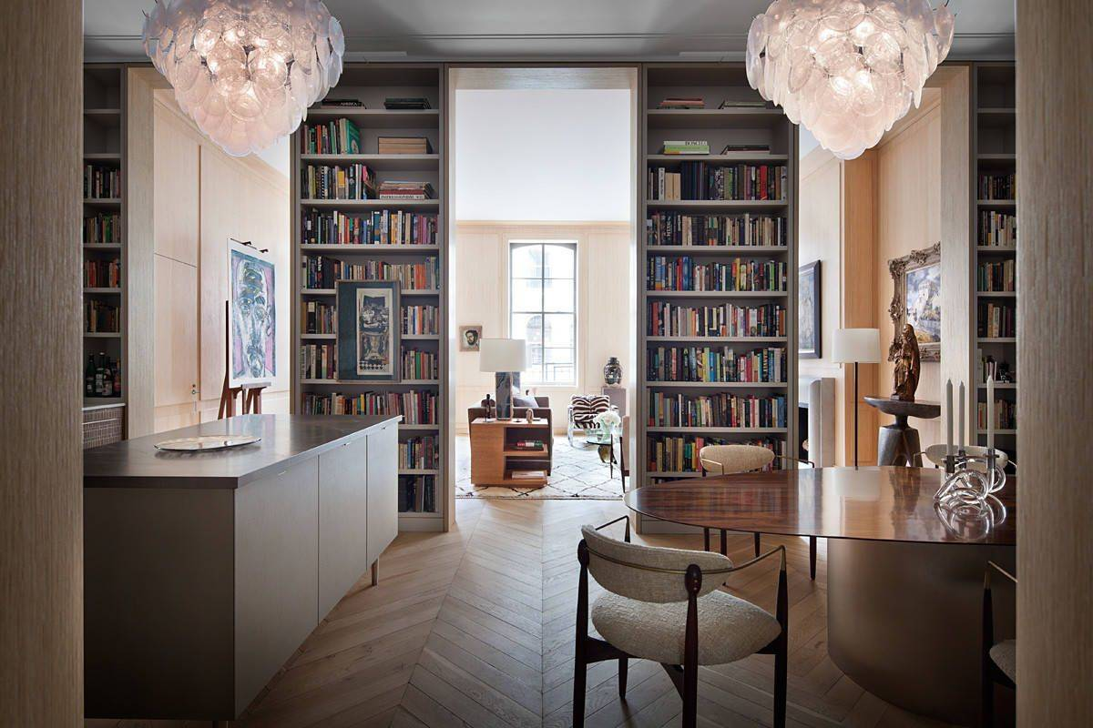 Dark-kitchen-island-unique-dining-table-and-custom-bookshelves-bring-sophitication-to-this-New-York-home-96420