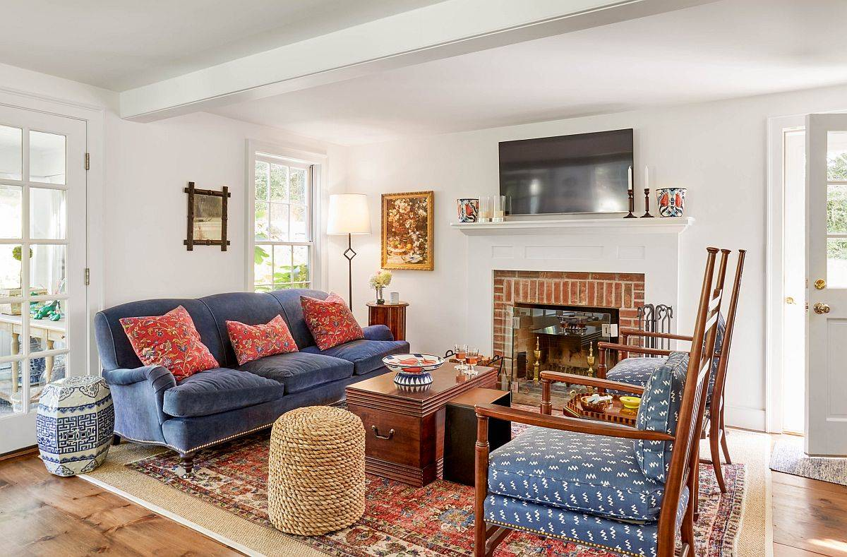 Decor, fireplace and brilliant colorful couches ramp up style in this modern farmhouse family room