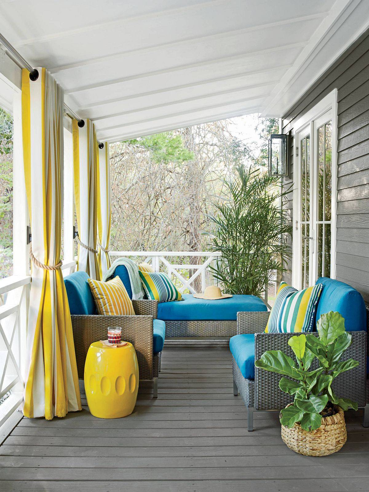 Delightful-use-of-blue-and-yellow-for-the-small-beach-style-porch-in-gray-96731